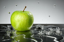 Green Apple With Water Drops O...
