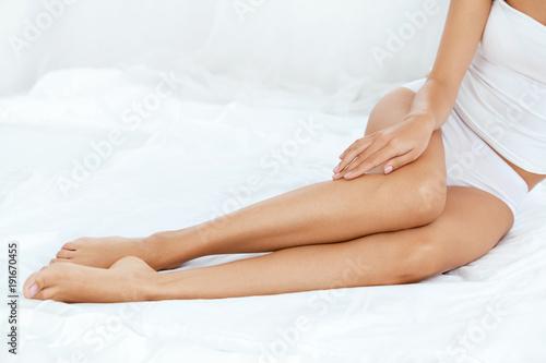 Fényképezés  Long Woman Legs With Smooth Soft Skin.