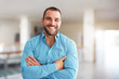 Leinwandbild Motiv Smiling man standing in business center