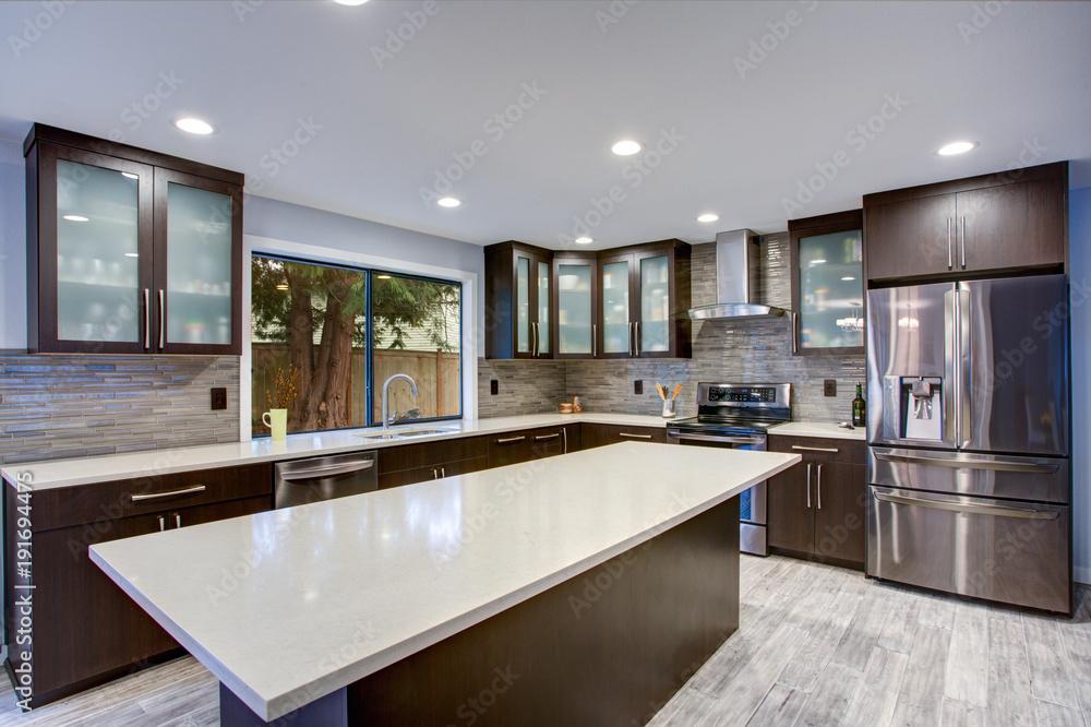Fototapeta Updated contemporary kitchen room interior in white and dark tones.