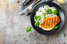 Chicken Breast Or Fillet, Poultry Meat Grilled And Boiled White Rice With Green Peas And Fresh Spinach Leaves. Healthy Diet Menu For Lunch