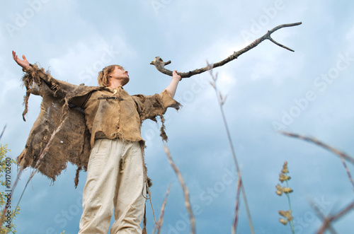 Fotografie, Obraz  druid causes the rain lifting to the sky a wooden stick