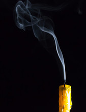 Yellow Candle And White Smoke ...