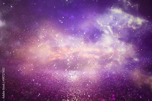 Purple and blue glitter lights background. defocused.