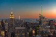 New York City, Manhattan skyline with urban skyscrapers at sunset.