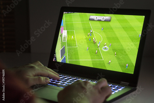 Soccer or football video game in laptop Poster