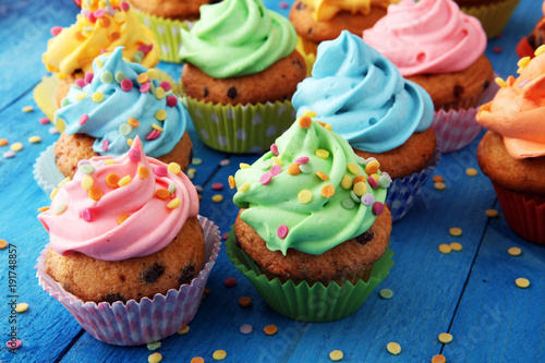 фотография Tasty cupcakes on wooden background