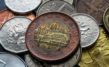 Czech Republic Currency, Fifty Crowns Coin Reverse With Prague Castles And Bridge On Stack Of Czech Coins Close Up