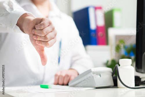 Valokuva  Doctor shows thumbs down