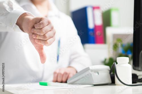 Fototapeta  Doctor shows thumbs down