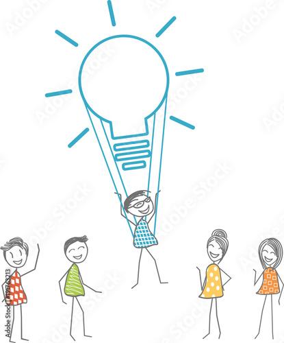 Photo Un homme s'envole grâce à une ampoule symbolisant une idée fabuleuse