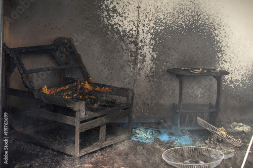chair and furniture in room after burned in burn scene of arson investigation co Canvas Print