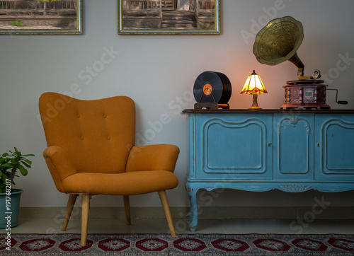 Vintage interior of retro orange armchair, vintage wooden light blue sideboard, Tablou Canvas