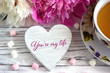 Valentines day greeting card with peonies tea cup marshmallow and lettering you are my life.