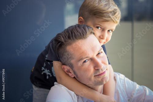 Fotografija  Embraced father and son.