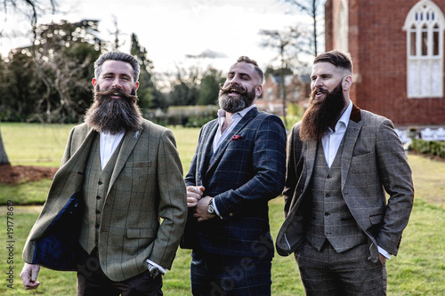Obraz na plátne Smart Men with beard and moustache wearing a suit near a castle