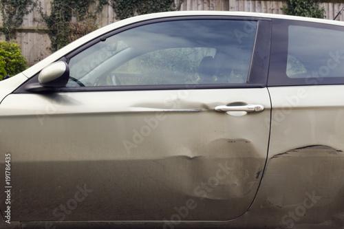 Fotografie, Obraz  Dents in the side of car