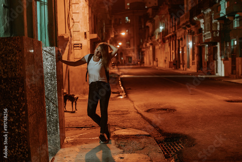 night scene on an orange lit street in the middle of the night in the cuban city Canvas Print