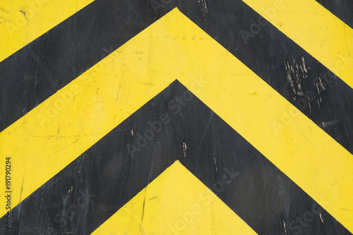 Obrazy żółte  black-and-yellow-steel-surface-of-industrial-equipment-warning-or-danger-pattern