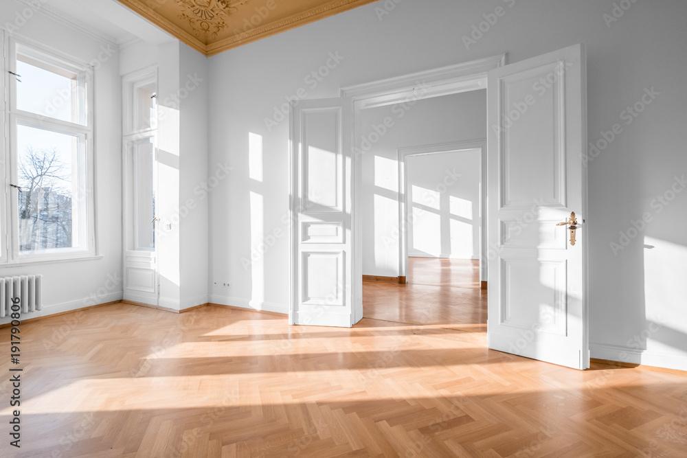 Fototapeta Empty room, flat with stucco ceiling ,  parquet floor and white walls  - obraz na płótnie