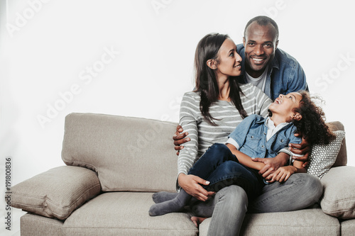 Fotografie, Obraz  Enjoyed parents and child sitting together with comfort
