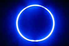 Round Glow Stick Of Blue Color/ Background From A Round Glow Stick Of Blue Color Like Neon On A Black Board