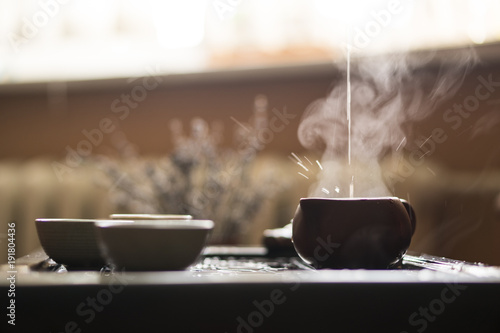 Staande foto Thee Pouring of Exquisite Hot Tea in Teapot at Traditional Chinese Tea Ceremony. Set of Equipment
