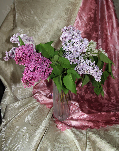 Fotobehang Lilac Lilac bouquet of in glass vase