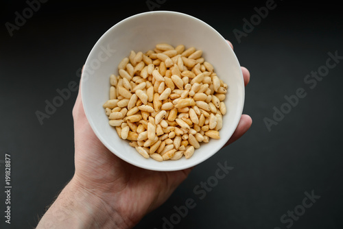 Puffed rice in white cup on dark background. Canvas-taulu