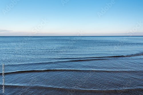 Fotografia  Still water in gulf of Riga, Baltic sea.