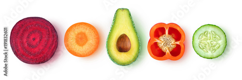 Foto auf Leinwand Gemuse Isolated vegetable pieces. Fresh slices of vegetables (beetroot, carrot, avocado, bell pepper, cucumber) in a row, top view, isolated on white background with clipping path