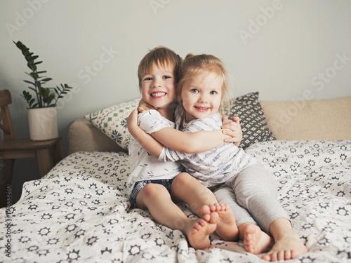Two pretty kids embrace Canvas Print