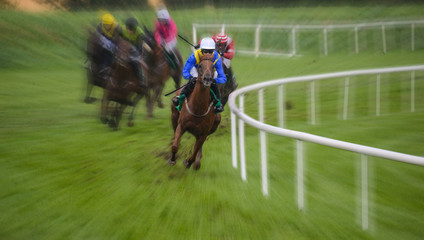Galloping racehorse in the lead on the track turn,zoom motion blur effect