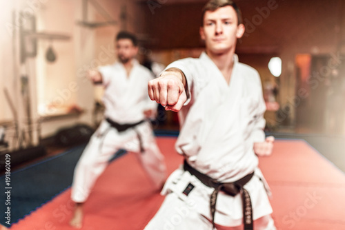 Fotobehang Vechtsport Martial arts fighters on workout in gym