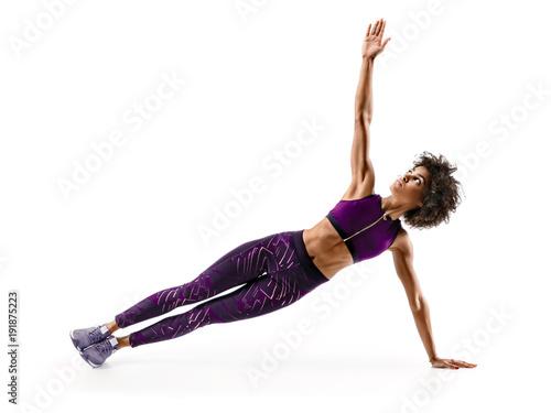 Fotografija Strong girl doing fitness plank position exercises