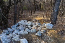 A Pile Of Stones In The Texas Forest On A Sunny Evening In February