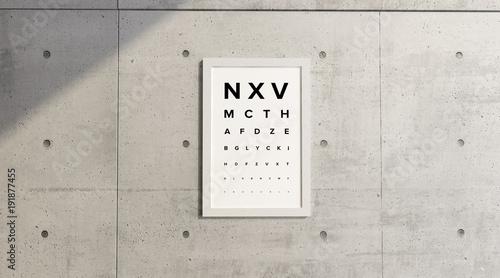 Tabella di misurazione della vista. Quadro appeso ad un muro in cemento. Esame della vista. Lettere in stampatello