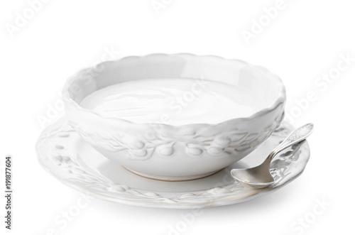 Deurstickers Klaar gerecht Tasty yogurt in dish on white background
