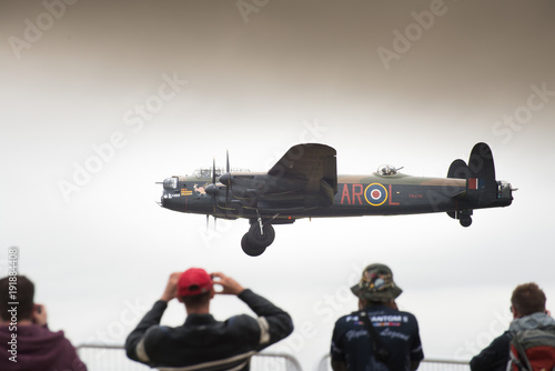 Photo Lancaster bomber coming into land at air show