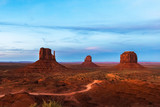 The West and East Mitten and the Merrick Buttes in Monument Valley Navajo Tribal Park at dusk, Arizona