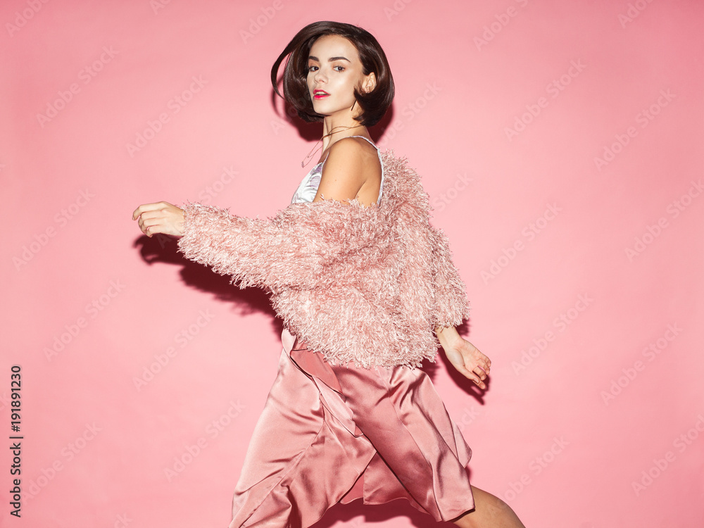 Fototapety, obrazy: young fashion woman in pink clothes run on pink background