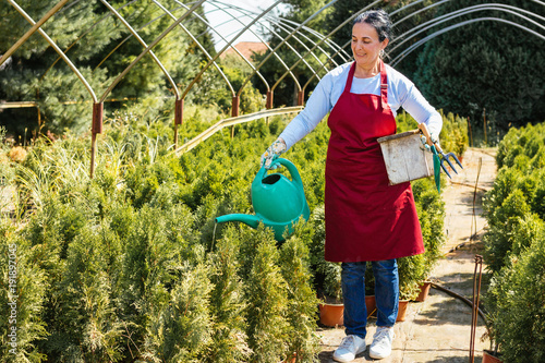 Gardening Farmer Holding Crate Of Organic Plants In Outdoor Plant Nursery Small Business