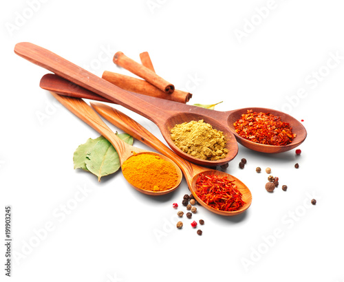 Printed kitchen splashbacks Spices Spice. Various spices in wooden spoons over white background. Curry, saffron, turmeric, cinnamon