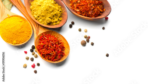 Recess Fitting Spices Spice. Various spices in wooden spoons over white background. Curry, saffron, turmeric, cinnamon