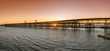 Panoramic view of Tinto river pier at sunset in Huelva, Spain.