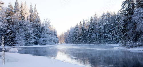 Fotobehang Bergen Sunrise river in a cold winter landscape with snow and frost