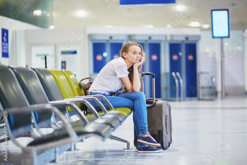 Fotografie, Obraz  Woman in international airport waiting for her flight