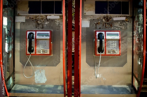 Fototapeta  two retro red phones booth boxes close up, isolated  on sunny day technology of