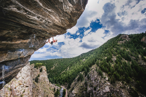 female climber hanging on an overhanging roof Canvas Print