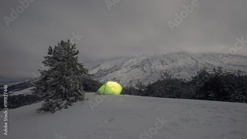 Vászonkép  Illuminated Tent On The Snow In Etna Park, Sicily